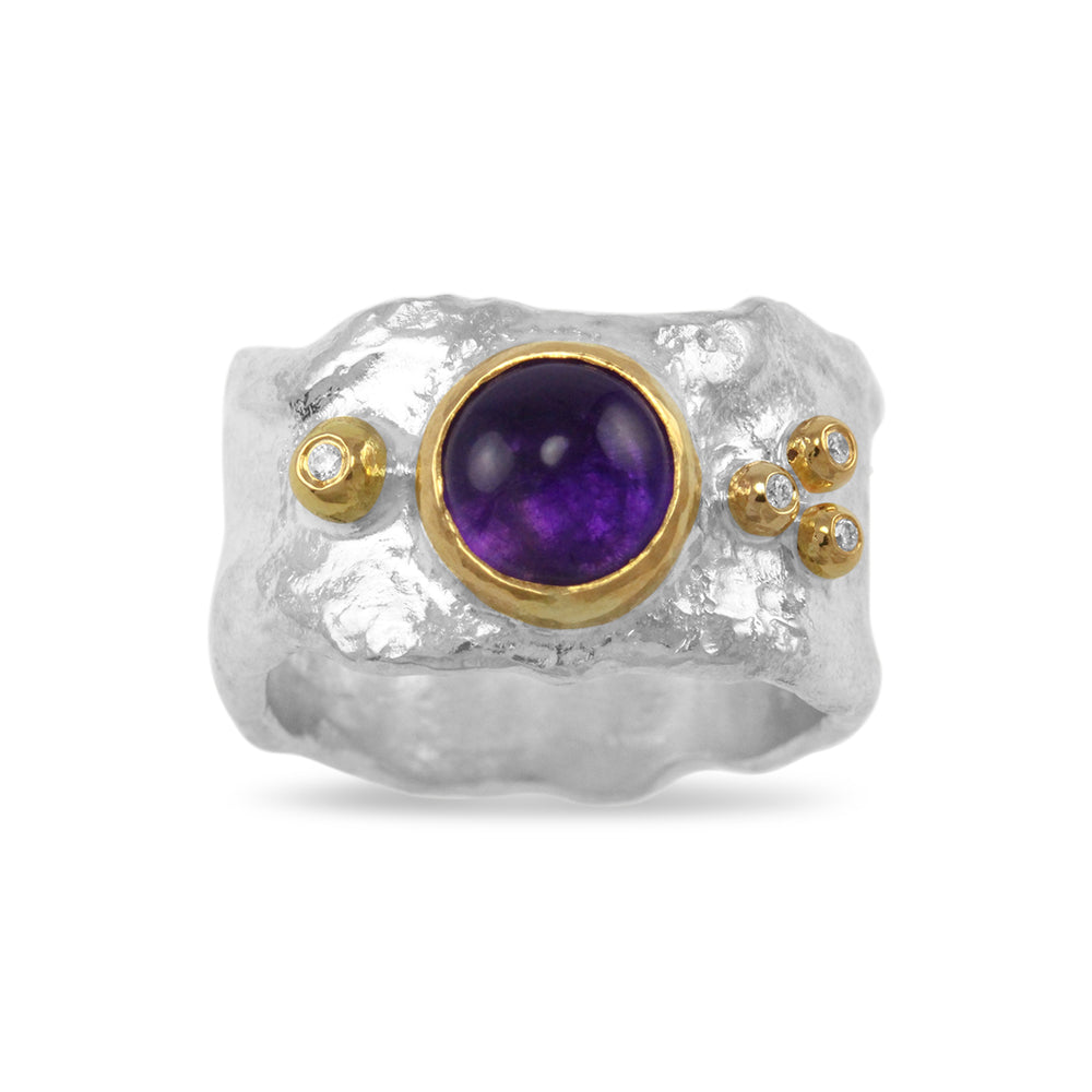 Silver rustic style ring set with amethyst and diamond.