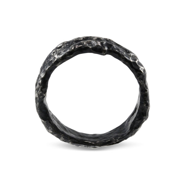 Ring in oxidised silver with a unique heavily melted organic texture. - Paul Magen