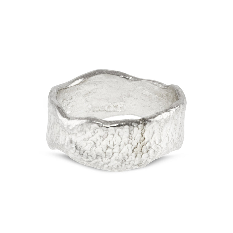 Contemporary ring handmade in sterling silver with a unique melted edge.