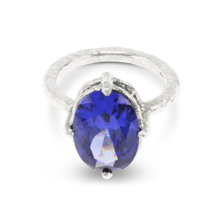 Handmade ring in sterling silver set with blue coloured cubic zirconia.