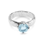Ring handmade in sterling silver with a rustic texture set with blue topaz gemstone.