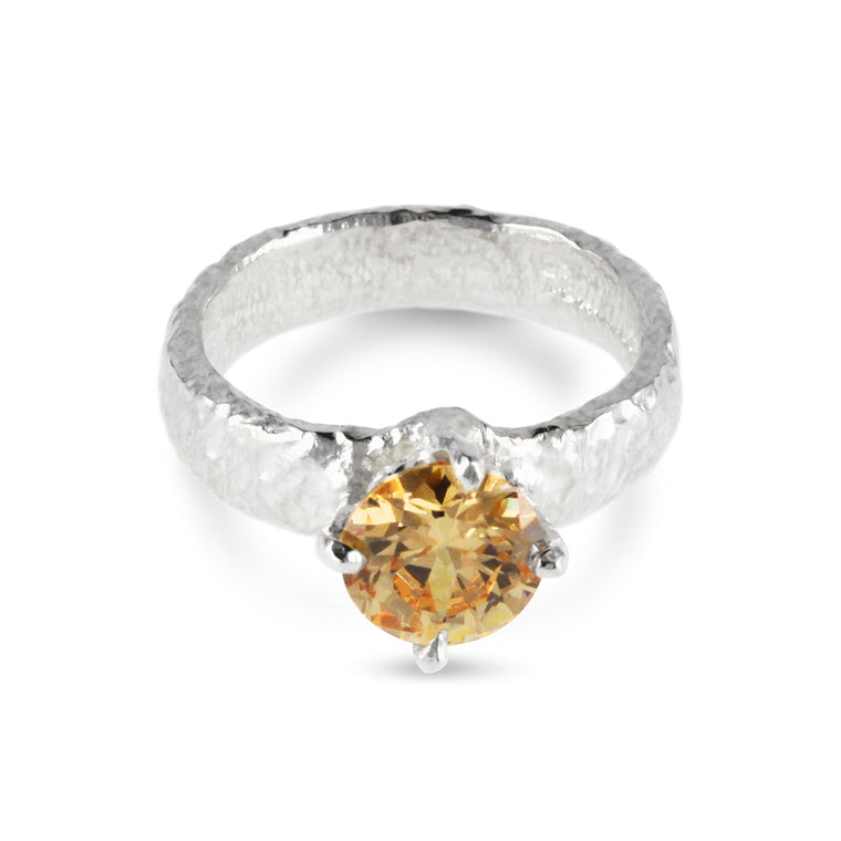 Ring handcrafted in sterling silver set with champagne coloured cubic zirconia stone.