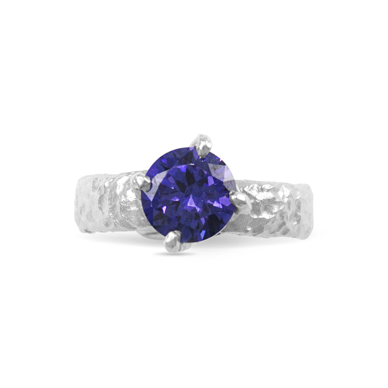 Contemporary ring handmade in sterling silver set with blue cubic zirconia stone.
