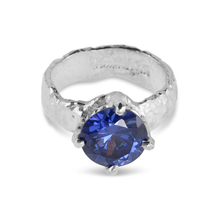 Contemporary sterling silver ring set with blue cubic zirconia stone.