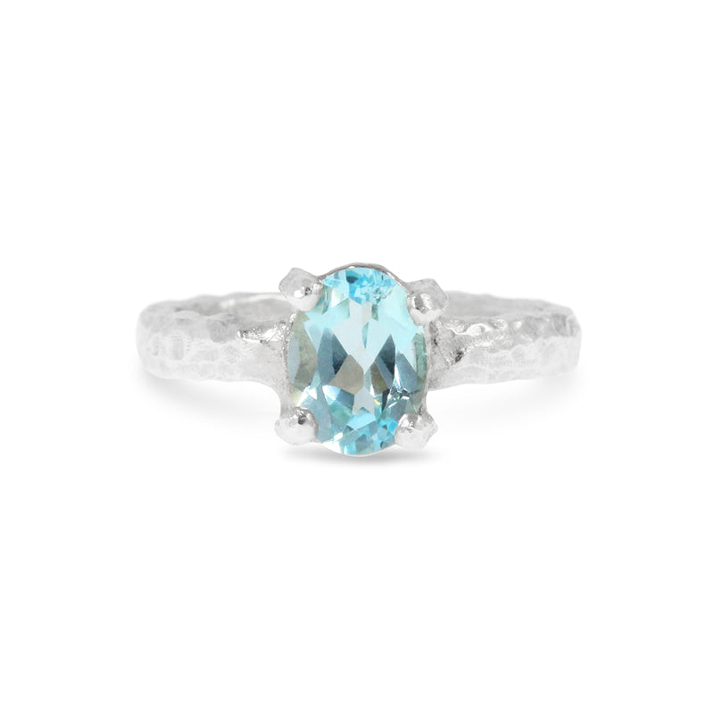 Unique handmade contemporary ring in sterling silver set with blue topaz.