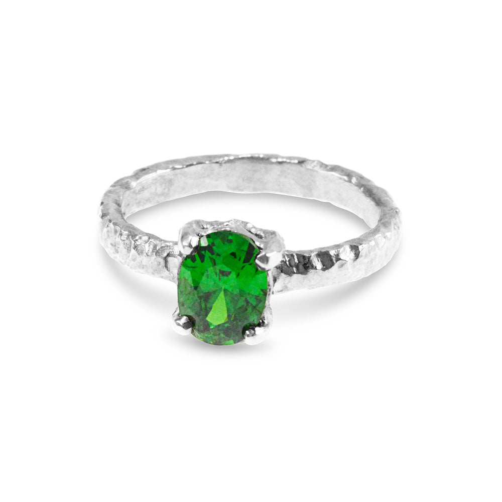 Designer ring handmade in silver with green cubic zirconia.