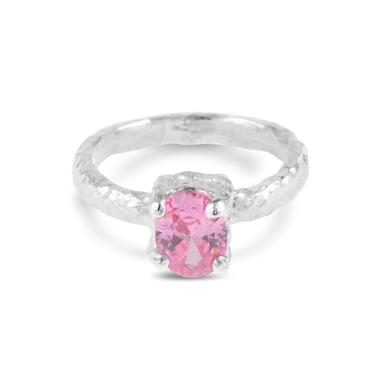 Contemporary ring handcrafted in sterling silver set with pink cubic zirconia.