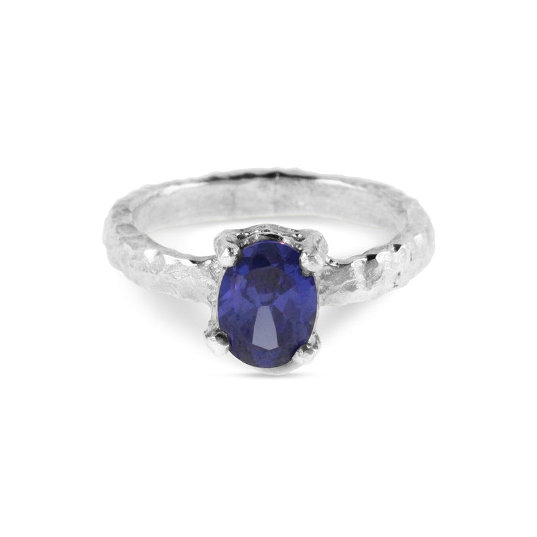 Ring handmade in sterling silver set with oval blue cubic zirconia.