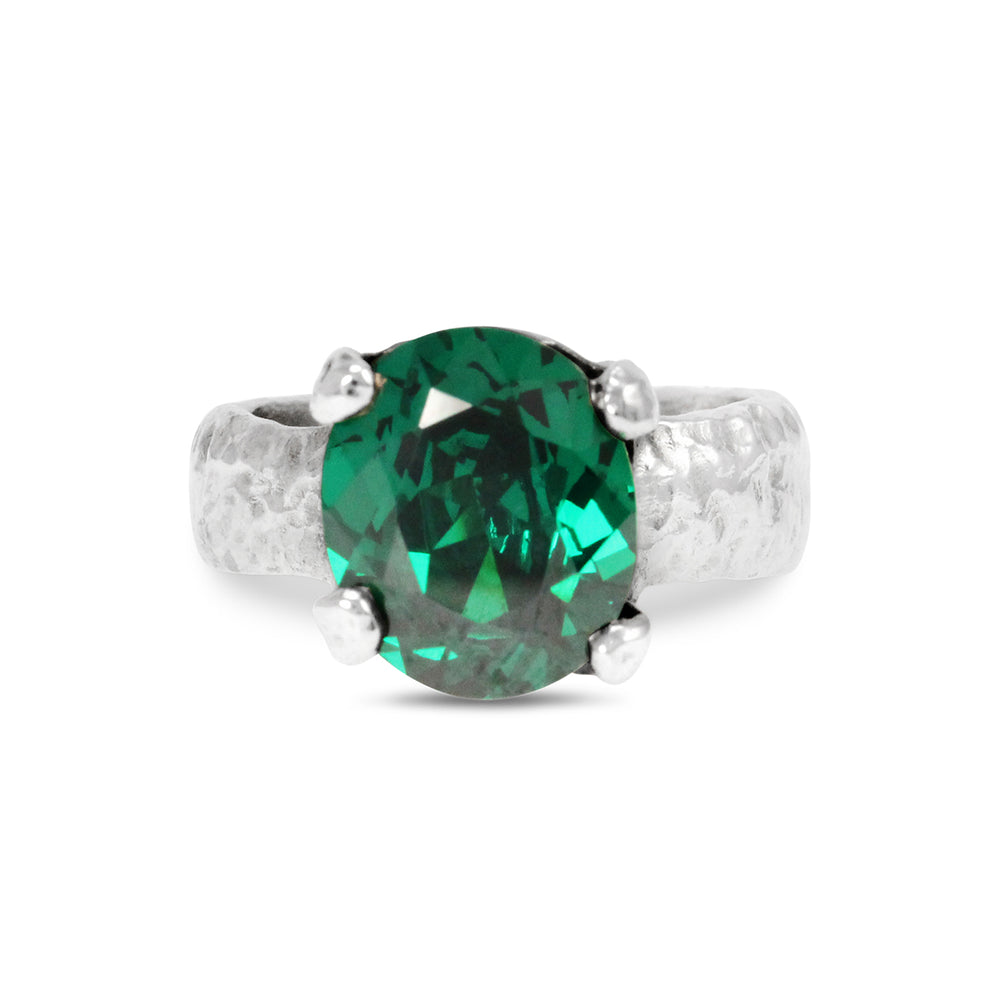 Ring handmade in silver set with green cubic zirconia.