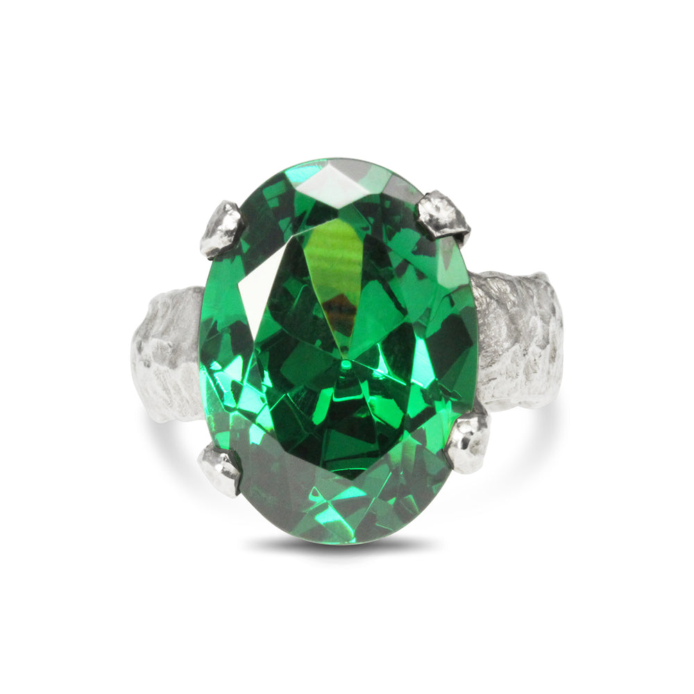 Silver designer ring set with green cubic zirconia.