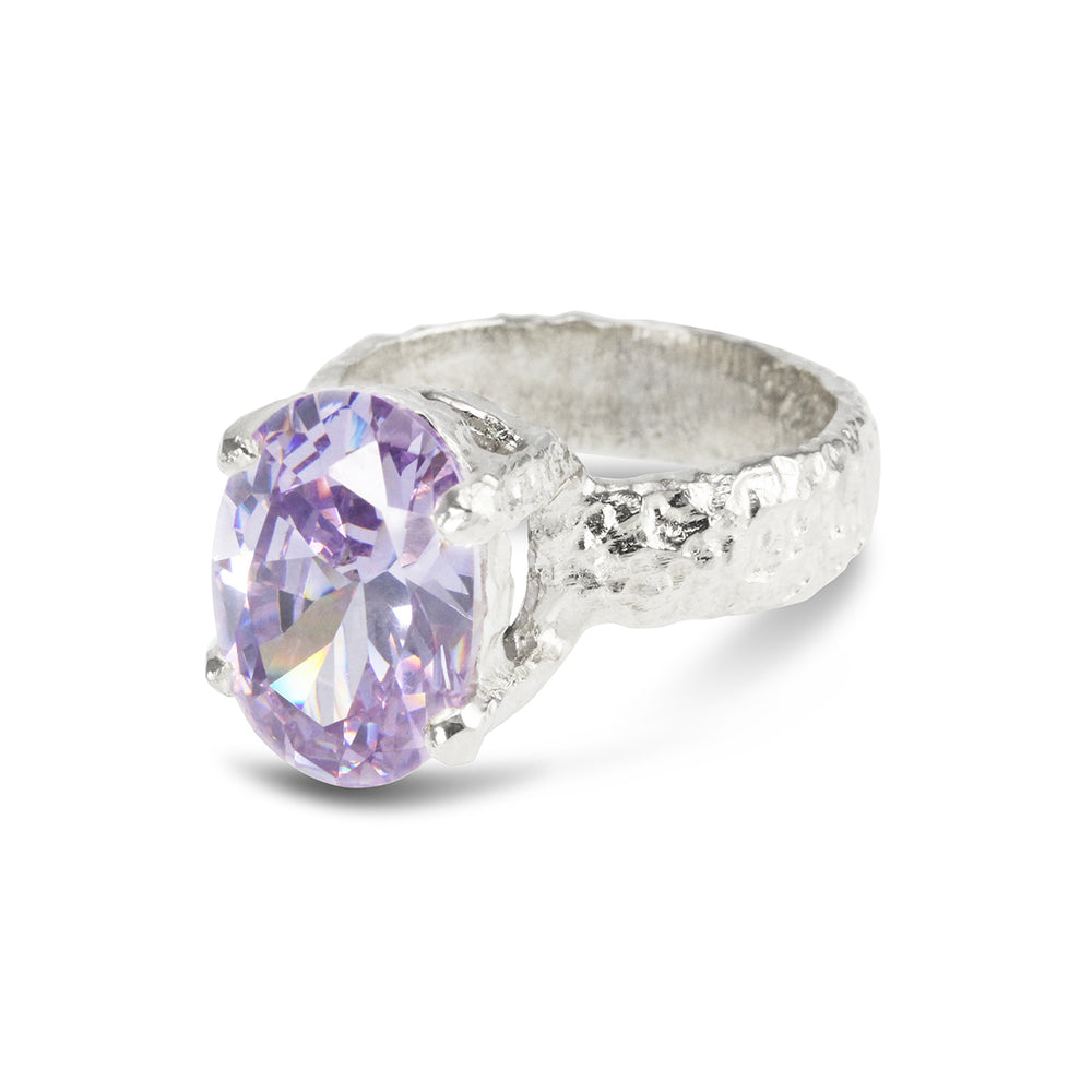Handmade ring in silver claw set with lilac cubic zirconia.