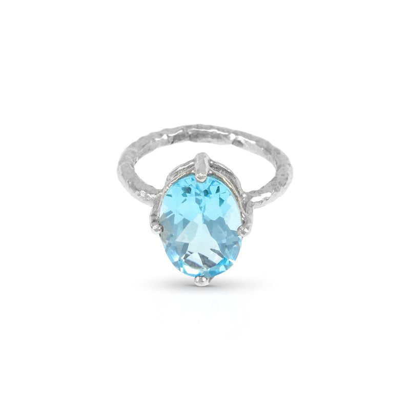Ring handmade in sterling silver set with blue topaz stone gemstone.