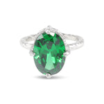 Handmade ring in silver set with green cubic zirconia.