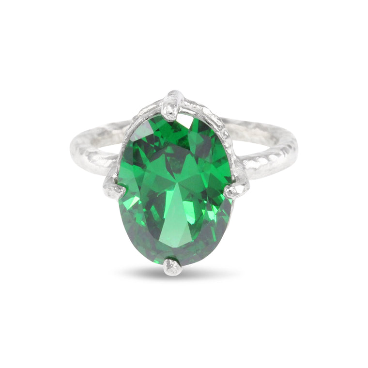 Handmade ring in sterling silver set with green coloured cubic zirconia.