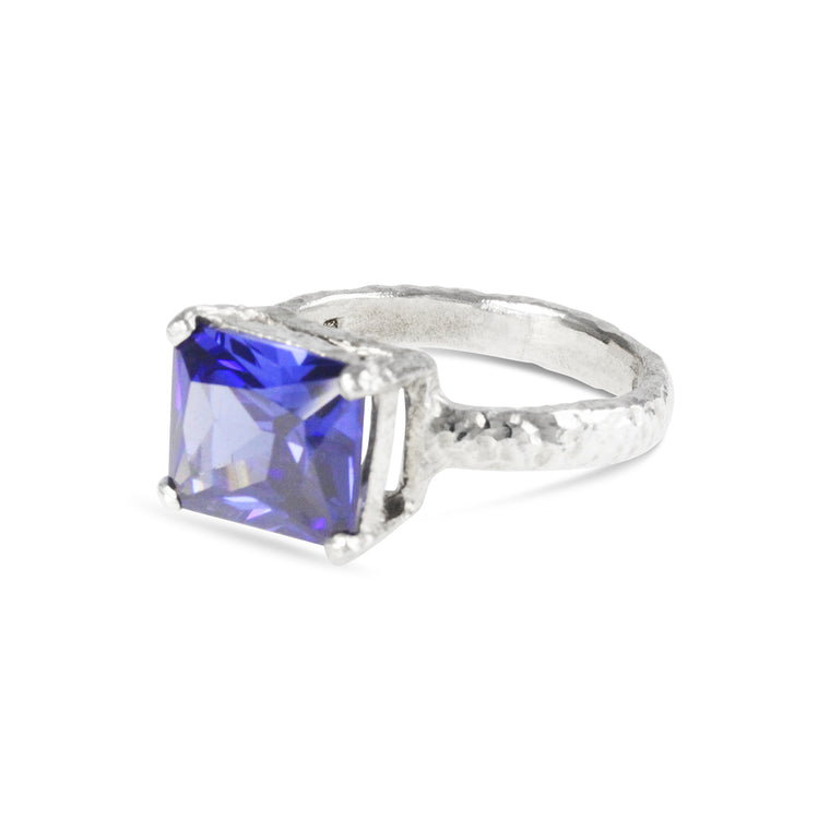 Ring in sterling silver with unique textured finish set with rectangle blue cubic zirconia.
