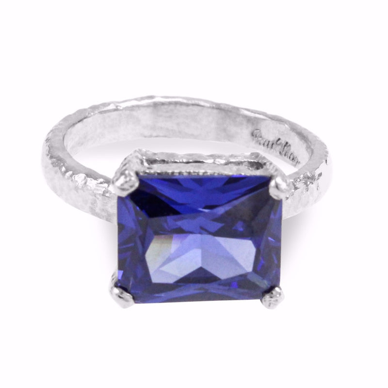 Ring in sterling silver with unique textured finish set with rectangle blue cubic zirconia. - Paul Magen
