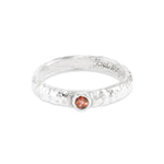 Garnet ring handmade in silver featuring an organic texture. - Paul Magen