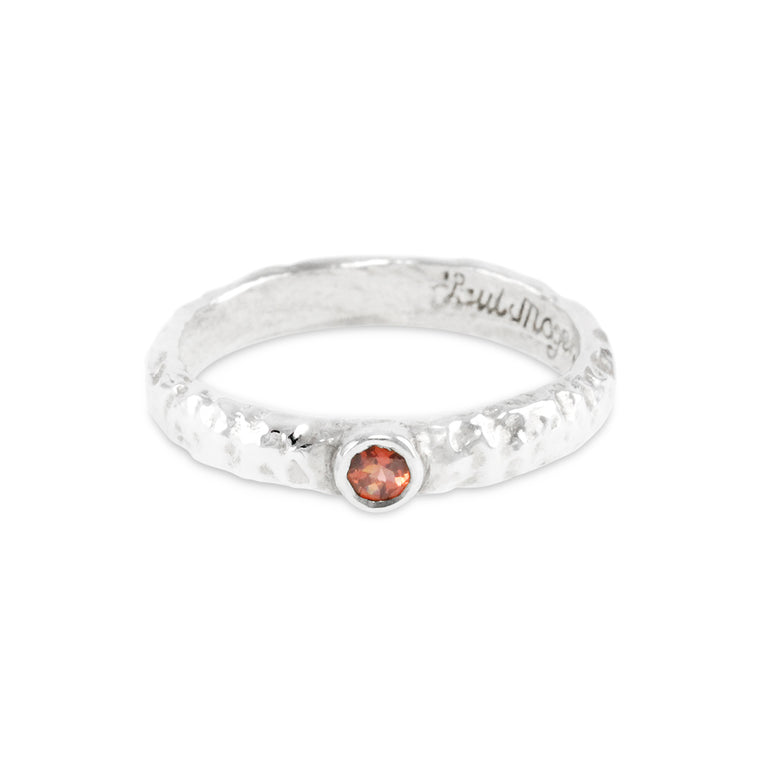Garnet ring handmade in sterling silver featuring an organic texture.