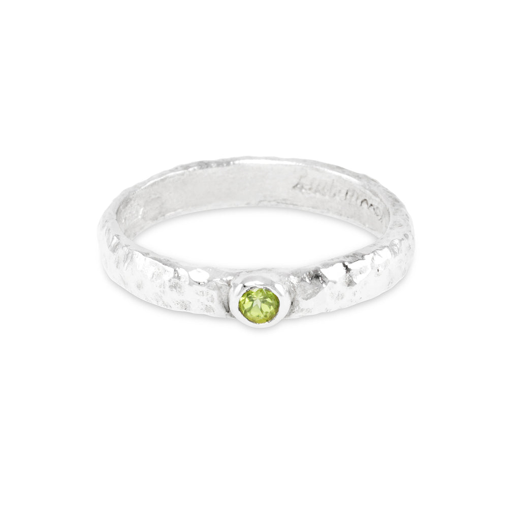 Peridot ring in silver handmade with an organic finish.
