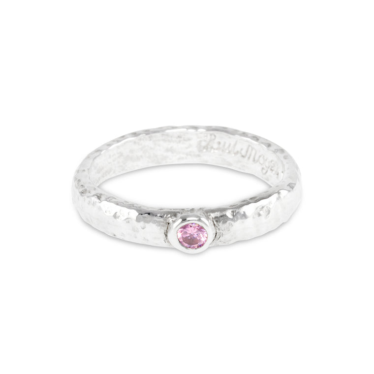Handmade ring in sterling silver set with pink cubic zirconia.