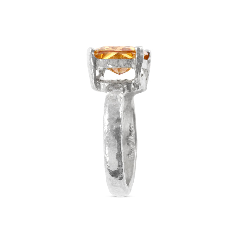 Designer ring in sterling silver set with  rectangle champagne cubic zirconia
