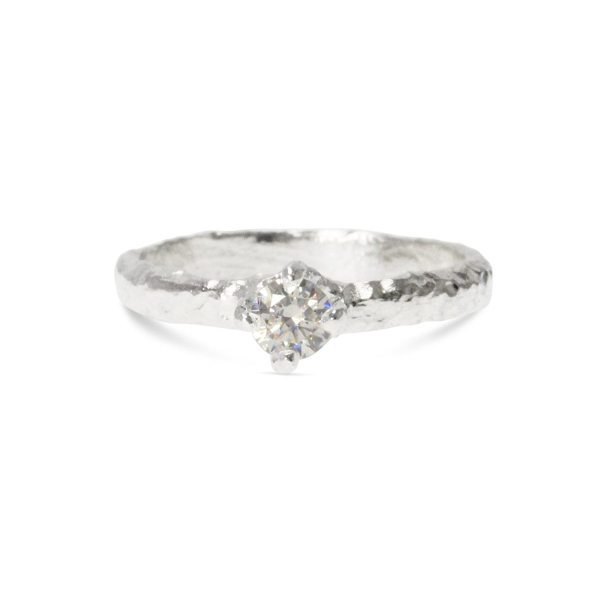 Handmade ring in sterling silver set with a white cubic zirconia. - Paul Magen