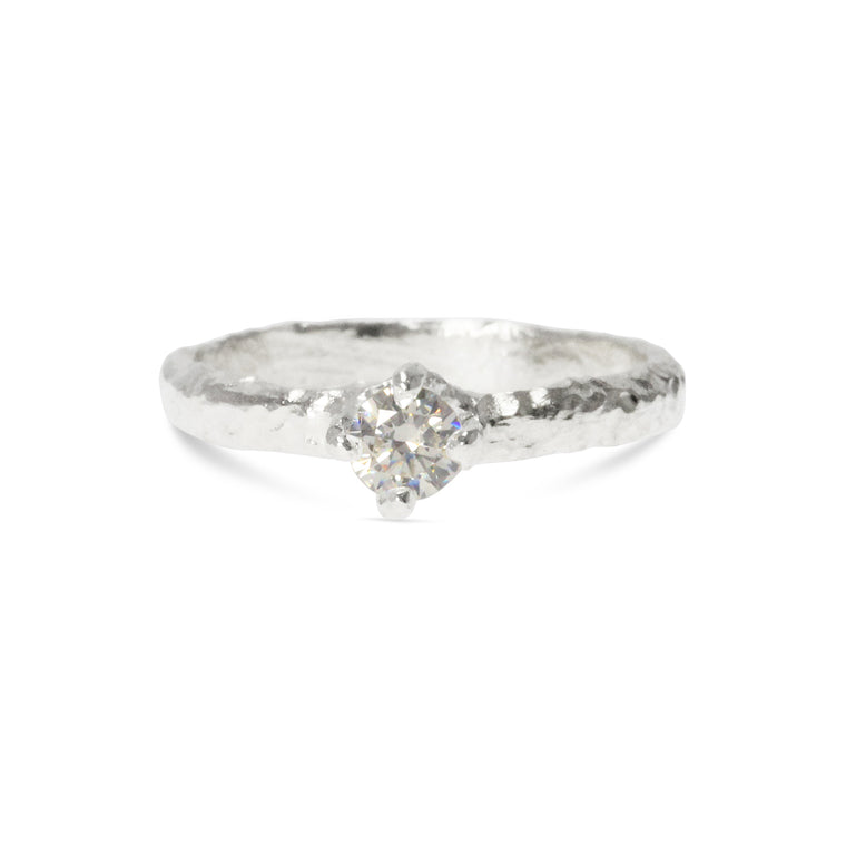 Teneo ring made in sterling silver set with  3mm white cubic zirconia