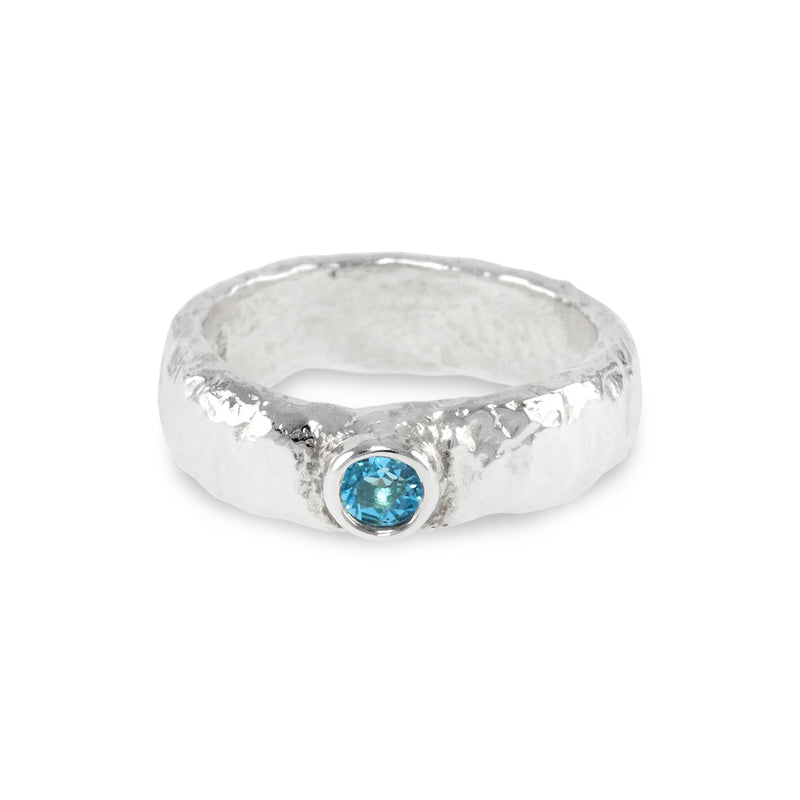 Handmade ring in silver set with blue topaz gemstone. - Paul Magen