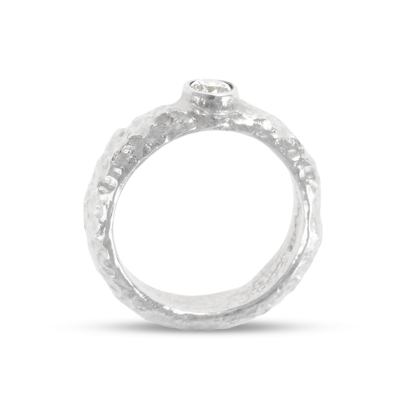 Sterling silver ring with a hand textured finish set with white cubic zirconia. - Paul Magen