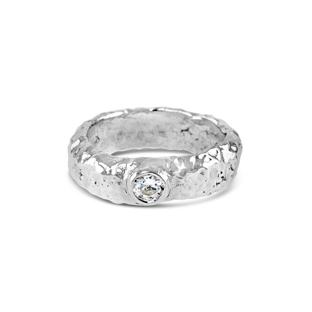 Silver ring hand textured finish with white cubic zirconia. - Paul Magen