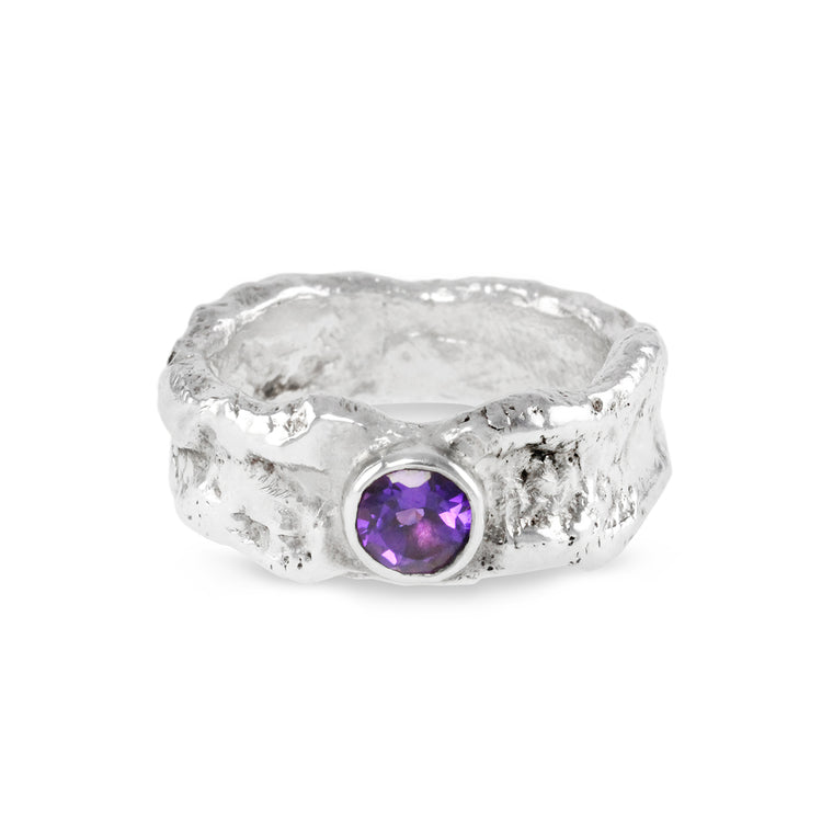 Amethyst ring handmade in sterling silver with a rugged organic melted finish.