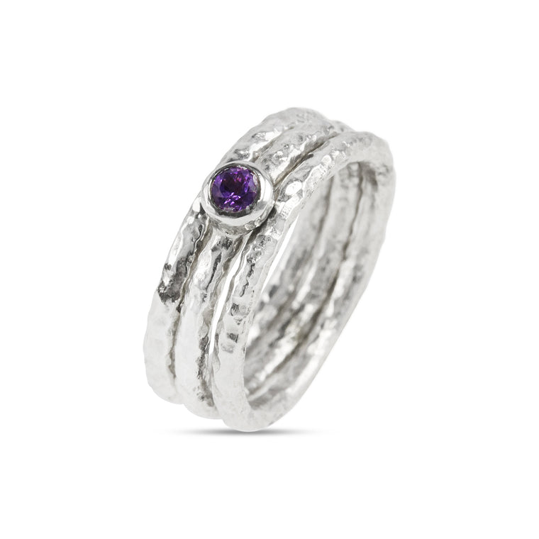 Handcrafted silver stacking rings made in sets of 3 centre ring set with amethyst.