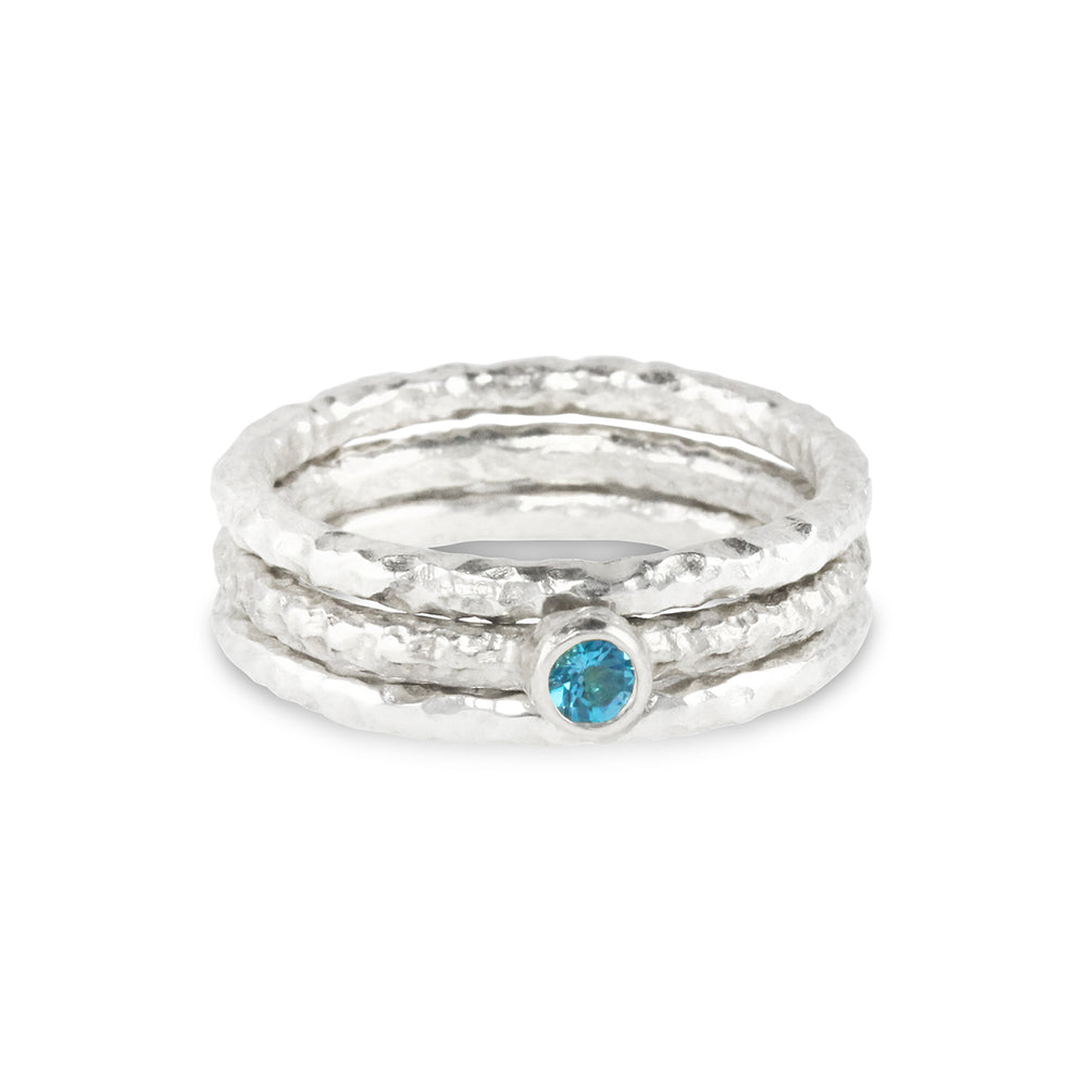 Stacking rings made in silver set with blue topaz.