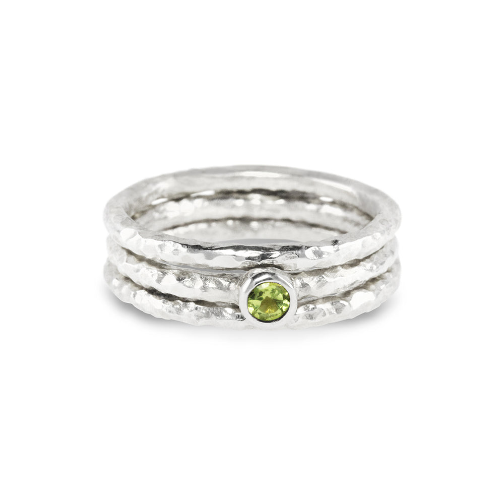 Stacking rings handmade in silver set with a peridot.