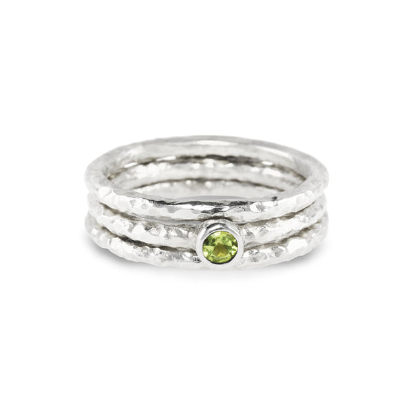Stacking rings handmade in silver set with a peridot. - Paul Magen