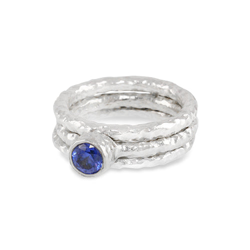 Handmade sterling silver stacking rings the centre ring set with an amethyst. - Paul Magen