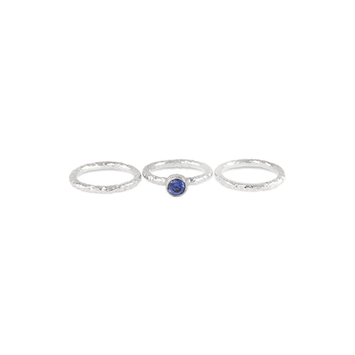 Handmade sterling silver stacking rings,  the centre ring set with an amethyst