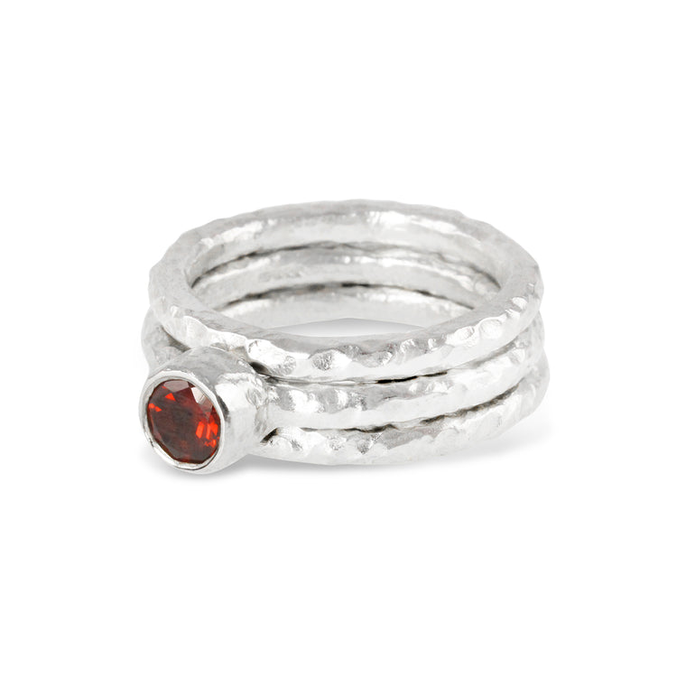 Handmade stacking silver rings in sets of 3 the centre ring set with a garnet.