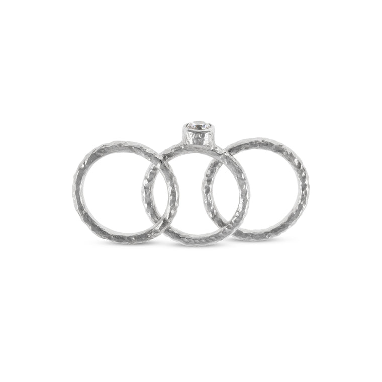 Handmade silver stacking rings in sets of 3 the centre ring set white cubic zirconia.