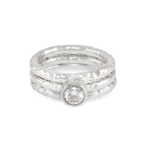 Tribus a set of 3 sterling silver rings,  the centre ring set with 5mm white cubic zirconia
