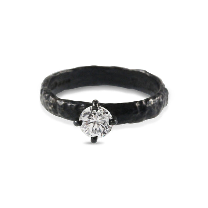 Ring handmade in oxidised sterling silver set with white cubic zirconia