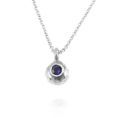 Silver designer pendant set an amethyst on a chain.