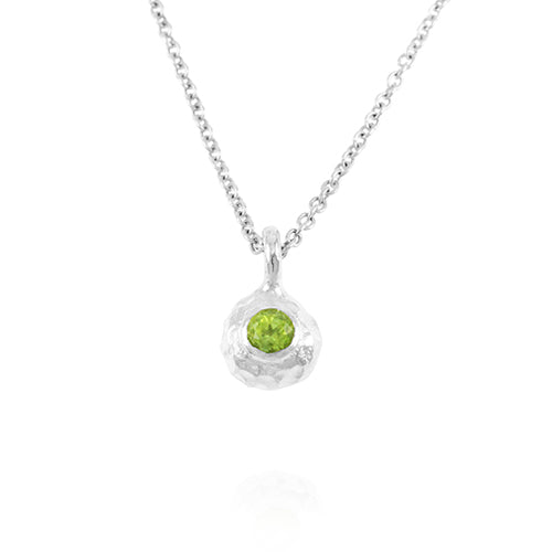Handcrafted silver pendant set with peridot on a chain.