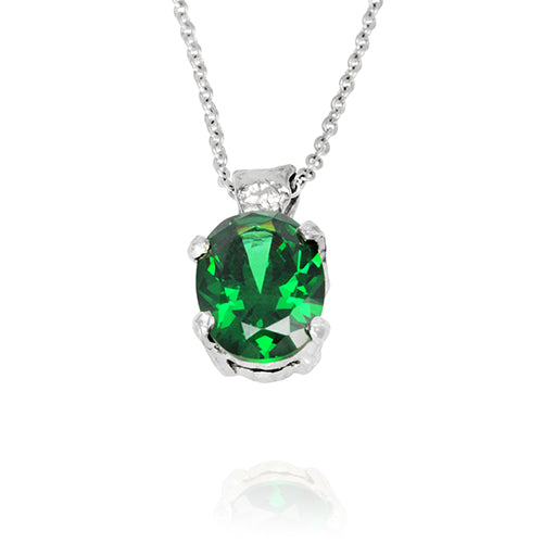 Silver pendant set with green cubic zirconia on a necklace.