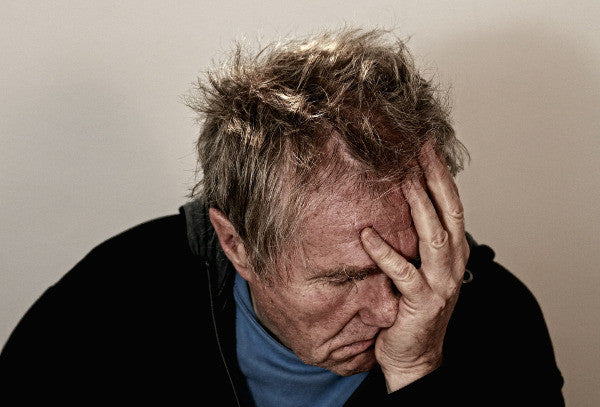 image of an older man suffering from some sort of head pain