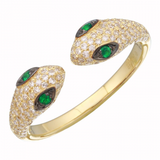 14k yellow gold diamond double snake ring with emerald eyes