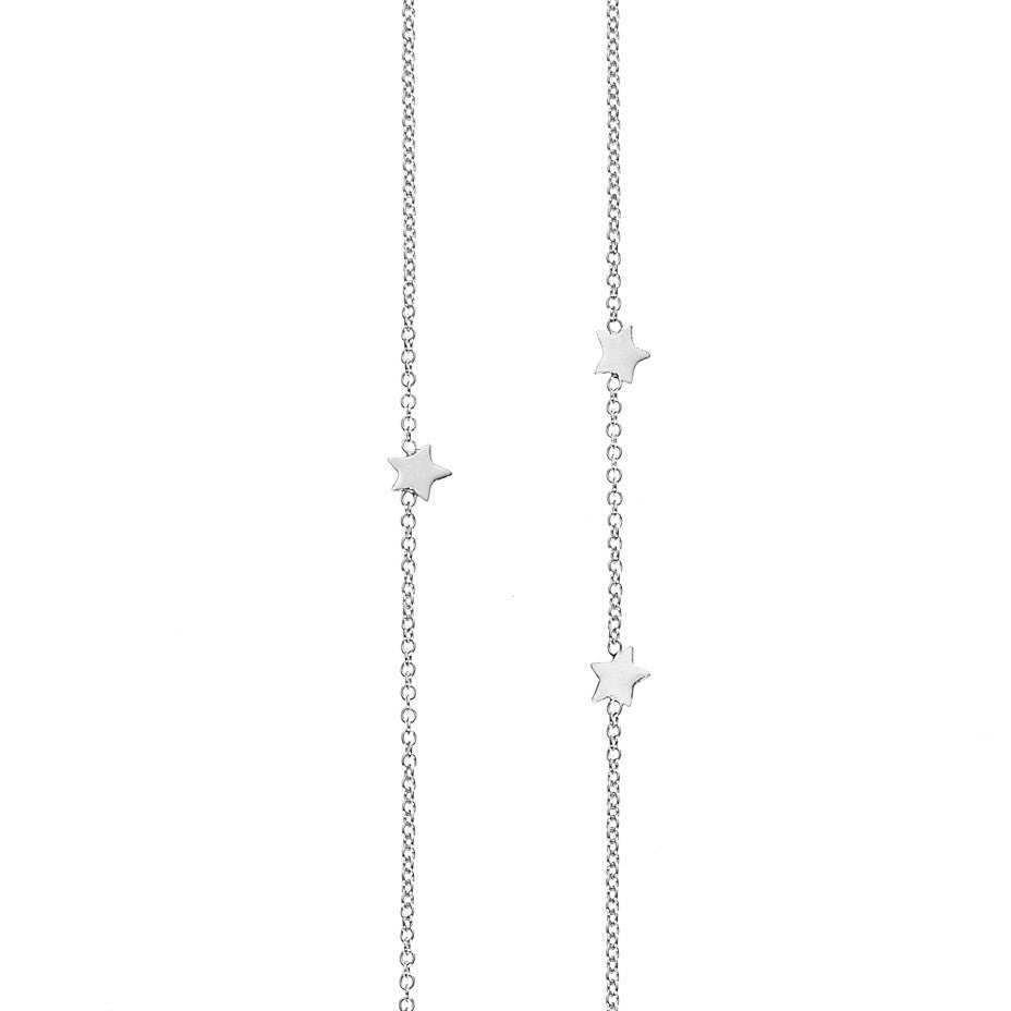 Eleven Star Long necklace in silver, featuring eleven shiny stars inserted into a chain in a random scatter to represent the night sky.