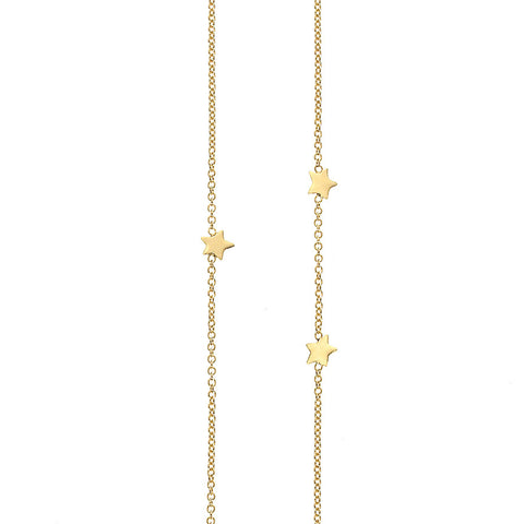Eleven Star Long necklace in gold, featuring eleven shiny stars inserted into a chain in a random scatter to represent the night sky.