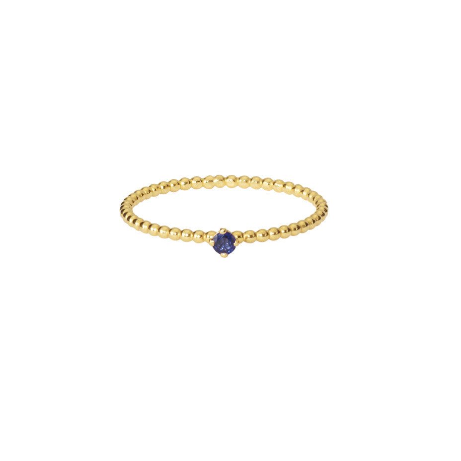 Royal Blue Sapphire ring in gold, featuring a claw set sapphire on our signature beaded band.