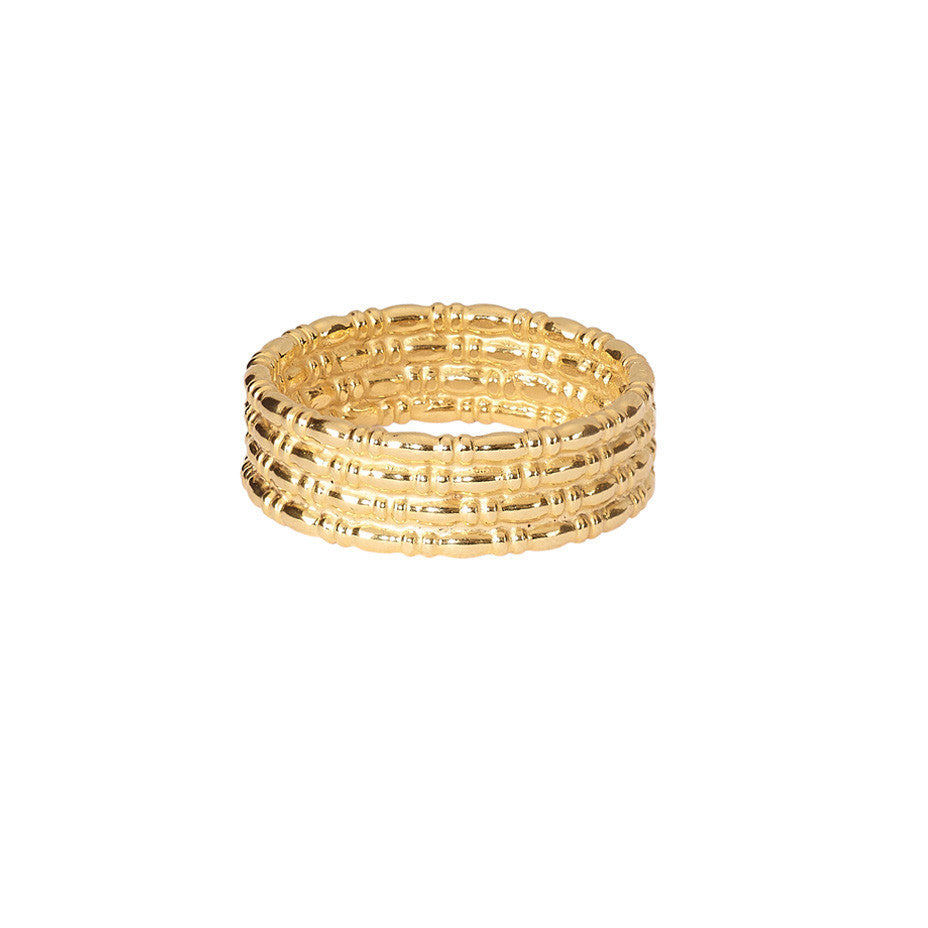 The Equine Wide Band ring in gold. A beautiful ring that echoes the bridle of horses.